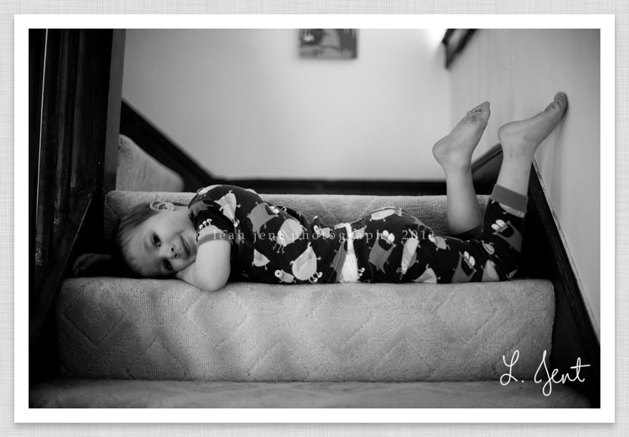 boy laying on the stairs