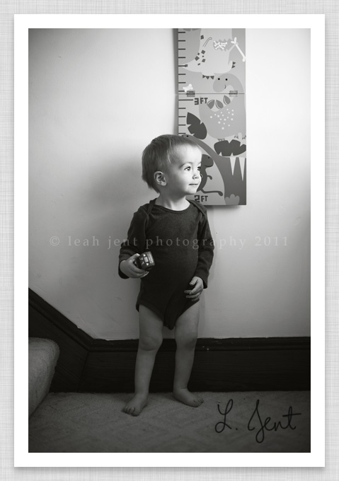 baby in front of a height chart