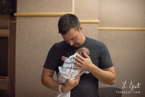 daddy holding his newborn daughter
