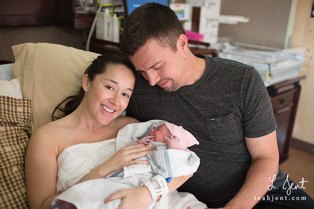 newborn girl and parents