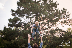 dad throwing son in the air